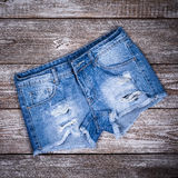 Ragged jeans shorts Stock Image