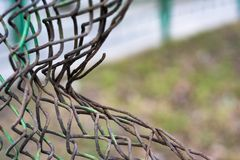 Ragged mesh fence. Soft focus stock photo