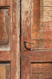Ragged old door Stock Photography
