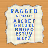 Ragged paper alphabet. Torn latin letters on lacerated piece of paper. Wood background Royalty Free Stock Images