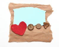 Ragged piece of old paper with heart. And button - tag Stock Photography