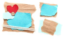 Ragged piece of old paper with heart. And button - tag Stock Photos