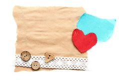 Ragged piece of old paper with heart. Ragged piece of old paper with lace, heart and button - tag Royalty Free Stock Image