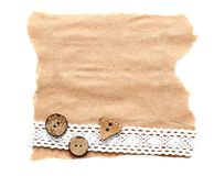 Ragged piece of old paper with lace and button. Tag Stock Image