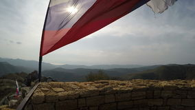Ragged Russian flag fluttering on wind. In fortress ruins stock video