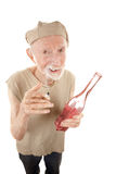 Ragged senior man with cigarette and liquor Stock Images