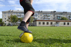 Ragged sneakers with a soccer ball royalty free stock photos