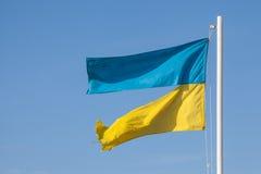 Ragged ukrainian flag. Divided Ukraine Stock Images