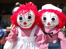 Raggedy Ann and Andy. Traditional Raggedy Ann and Andy dolls with red yarn hair and matching gingham oufits royalty free stock image