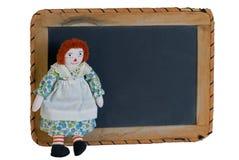 Raggedy Ann mit Schule-Schiefer-Tafel Stockbild