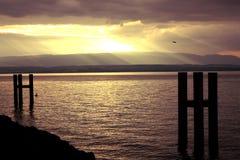 Raggi di Sun sul lago immagine stock libera da diritti