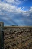 Raggi e terreno coltivabile di Sun Fotografie Stock Libere da Diritti