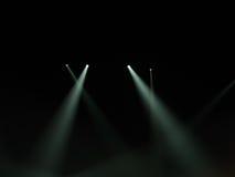 Raggi luminosi del punto nella nerezza Immagine Stock Libera da Diritti