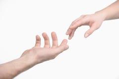 Raggiungimento della mano. Fotografie Stock