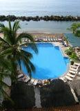 Raggruppamento e laguna del Playa Del Sol Costa Sur Immagini Stock