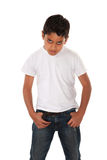 Raging Boy. Angry youngster in t-shirt and hands in pockets royalty free stock photos
