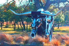 Raging Bull. Chrome bull made of various metal parts, layered and color enhanced for effect Stock Images