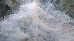 Raging clean fresh mountain river flowing between. Rocks HD stock video footage