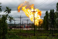 The raging flame of an oil fountain in Siberia. Fire on an oil well in Siberia. The flame of the oil fountain is raging Royalty Free Stock Images