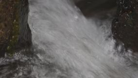 Raging flow of the waterfall . Raging flow of the waterfall