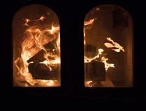 Raging forks of flame in fireplace royalty free stock photography