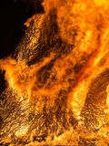 Raging inferno, fire outdoors at night Stock Images