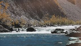 Raging Mountain river. Wildness of clean, clear water in the mountain river. far shot stock footage