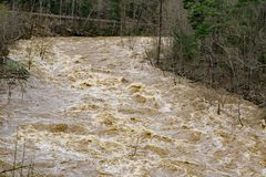 The Raging Power of the Flooding of the Maury River. The raging power of the flooding on the Maury River in Goshen Pass located in the Rockbridge County stock image