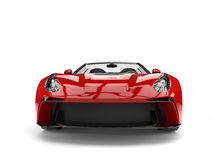 Raging red awesome sports car - front view closeup shot Stock Photography