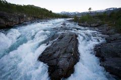 Raging river in mountain plateau Valdresflye, Jotunheimen stock image