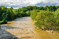 Raging Roanoke River - Hurricane Florence in 2018. The raging Roanoke River at flood stage the rising waters was caused by Hurricane Florence in 2018 royalty free stock image