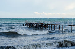 The raging sea and wooden jetty. Storm. Royalty Free Stock Images
