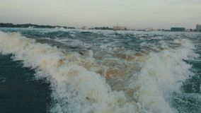 Raging water from motor boat on river. Summer evening. Nature. Waves. Landscape. stock footage