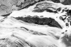 Raging Waterfall. This was one of the waterfalls at Yellowstone National Park. It had very dark rocks behind it, which made a black and white composition very Royalty Free Stock Photo