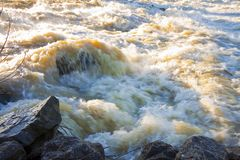 Raging waters and murky - Flooding after several days of torrential rain.  stock photo