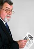 Ragioniere di imposta con il modulo di imposta 1040 Fotografia Stock Libera da Diritti