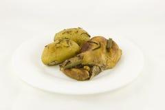 Ragoût de lapin et pommes de terre cuites au four avec le romarin Image libre de droits