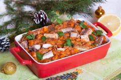 Ragoût de poissons avec des légumes en sauce tomate Images stock