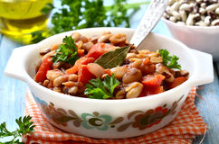 Ragout from beans with bell pepper and onion. Royalty Free Stock Images