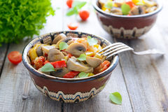 Ragout from mushrooms with  sweet peppers Royalty Free Stock Photography
