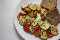 Ragout of zucchini on plate Royalty Free Stock Images