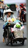 The ragpicker in the Ho chi minh city street. Taken in Ho chi minh Saigon city, the ragpicker is in street with a smile Royalty Free Stock Photography