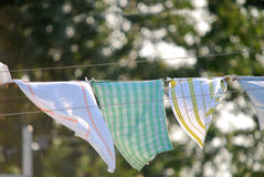 Rags on clothes line. Close-up floating in the wind Stock Image