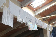 Rags and dish towels hanging in the attic Stock Image
