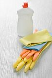 Rags gloves and bottle Stock Photography