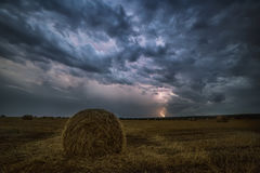 Rags of hay on the field and lightning. night photo, Royalty Free Stock Photos
