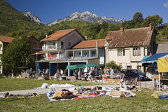 Rags and household item vendors with local shoppers at an outdoor market, Jablanica, Bosnia and Herzegovina Stock Photos