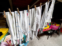 Rags hung to dry in the laundry room in the attic of a kindergar Stock Image