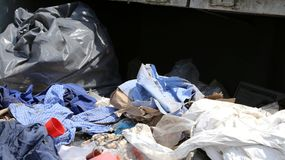 Rags and waste fabrics in the landfill for collecting recyclable. Many rags and waste fabrics in the landfill for collecting recyclable material Stock Image