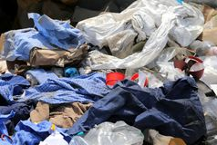Rags and waste fabrics in the landfill. For collecting recyclable material Royalty Free Stock Photo